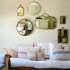 mirror gallery wall and grain sack pillows; Vintage Mirrors, Funky Mirrors, Retro Mirror, Large Mirrors, Rustic Mirrors, Round Mirrors, Home And Deco, Scandinavian Home, Home Fashion