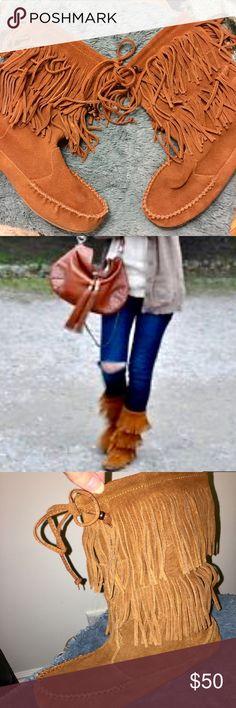 Minnetonka Moccasins Tall Fringe Boots 9 Super cute Minnetonka moccasins tall boots/booties with fringe details, worn a few times, only minor wear 🔑🍂🍁❤️ Minnetonka Shoes Ankle Boots & Booties