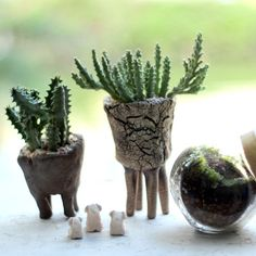 Legs give these handmade pottery planters a sense of whimsy.