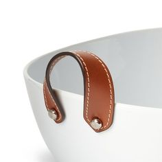 Ralph Lauren's best-selling Wyatt collection is updated this season by pairing smooth porcelain with supple leather accents. Contrast stitching at each handle enhances the equestrian appeal of this elegant salad bowl. #SilverHomeAccessories Silver Home Accessories, Brand Sale, Bath Decor, Salad Bowls, Women Brands, Sale Items, Porcelain, Ralph Lauren, Luxury