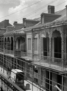 Upper stories of buildings with wrought iron balconies. New Orleans, Louisiana, 1925. 4x5 nitrate negative by Arnold Genthe.