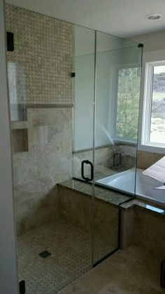 Frameless shower #brittandtilson #asheville #wnc #glass #bathroom #remodel #custom #light #open