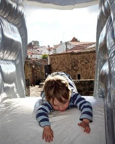 Festas in Portugal really are fantastic. We went to an Olive Oil and Smoked Meats festival which even had a free bouncy castle  Portugal! Post on the blog #familytravel #portugallovers #explorerkids