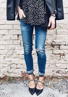 Long patterned tunic blouse, rolled skinny distressed jeans, lace-up pointy toe flats, leather jacket