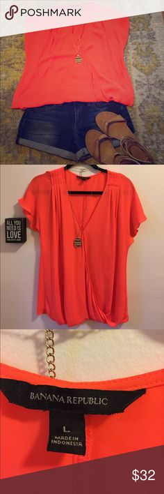 Coral Banana Republic blouse 👚 🦄Worn Once🦄 Beautiful coral blouse v-neck with a swoop along the front. Pleats at the shoulders and wraps under at the waist for a perfect 👌🏼 fit.  Looks great casual with jean shorts or add a pop of color under a suit! Banana Republic Tops Blouses