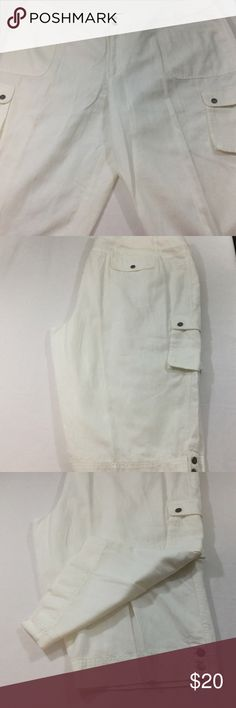 Liz Claiborne 24W white ladies capris Cargo Style This is a pristine white pair of Ladies Liz Claiborne Capri style pants 24W  Pockets on the sides similar to cargo pants  Very stylish with snaps on the bottom of the legs  They measure approx. 23 inches across the waist for a total of 46 inches  around the waist  The inseam is 14 inches and they are 18 inches from the waistband to the crotch  The opening across the bottom of the leg is 11 inches laying flat  They are 30 inches from waistband…