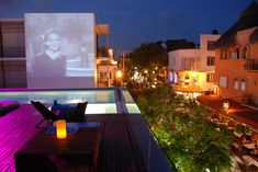 roof top patio at Deseo Hotel in Playa Del Carmen. they project black and white movies onto the Hotels brick wall at night