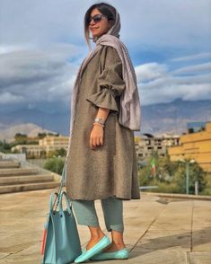 persian fasion_iranian woman_Image may contain: 1 person, standing, sky and outdoor Street Hijab Fashion, Abaya Fashion, Muslim Fashion, Fashion Dresses, Mode Abaya, Mode Hijab, Iranian Women Fashion, Womens Fashion, Hijab Fashion Inspiration
