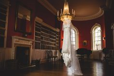 the wedding dress hanging in the library at iscoyd park