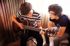 Louis Tomlinson & Harry Styles  i think it would be awesome to go on tour with them and sing!!:)