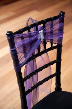 Black chairs, purple tulle and rhinestone band