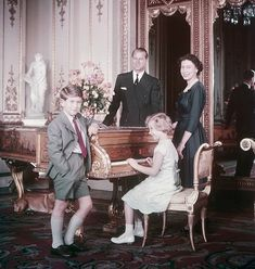 Nine year old Prince Charles strikes a pose with Queen Elizabeth, Prince Phillip, and Princess Anne, October