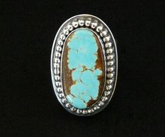 This elegant No. 8 Turquoise and Sterling Silver Band Ring was crafted by Nevada Silversmith Jim Daggett. No. 8 Turquoise varies from light blue to dark blue, with a black, golden, red or brown matrix