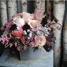 Love these blush pinks, grey, merlots, and pretty barely there succulents