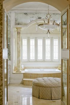 Tobi Farley. Stunning bathroom with shutters and beautiful ottoman.