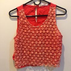 Orange Crochet Overlay Cropped Tank Top Small The Hanger, Orange, front is lined underneath the crochet! Button peep hole closure at the upper back. Really cute and looks great with a tight maxi skirt! The Hanger Tops Crop Tops