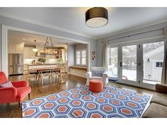 Love how this blue and orange patterned rug brightens up the living room! -- 4029 York Avenue S, Minneapolis, MN 55410