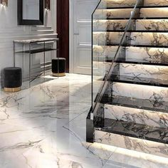 Subtle LED Staircase lighting showcases the attention to dest and the beautiful . : Subtle LED Staircase lighting showcases the attention to dest and the beautiful Calacatta marble. Home Stairs Design, Interior Stairs, House Design, Stair Design, Marble Staircase, Modern Staircase, Wood Stairs, Tile Stairs, Wood Railing