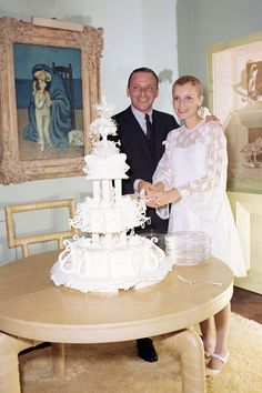 Bride Mia Farrow in 1966 with Frank Sinatra at their reception in the William & Edith Goetz house. The Goetz house was decorated by Billy Haines.