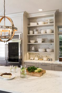 some open shelving with subway tiles in background