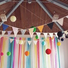 Rainbow bunting, streamers and lanterns  Link in bio. Image by @beckyjphotography