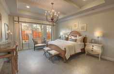 Traditional Master Bedroom with Chandelier, LifeProof Lilypad - Color Pinstripe 12 ft. Carpet, Crown molding, High ceiling
