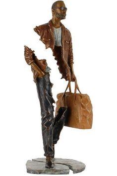 """""""Mattéo"""" sculpture bronze de Bruno Catalano, sculpteur français (1960) qui a toujours été inspiré par le thème universel du voyage. Photo de détail : http://brunocatalano.com/sculptures/catalano-bruno1341390028A.jpg - photo de dos : http://brunocatalano.com/sculptures/catalano-bruno1341390028B.jpg"""