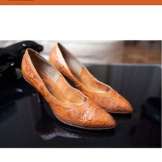 Omg, hand tooled leather shoes! These are awesome