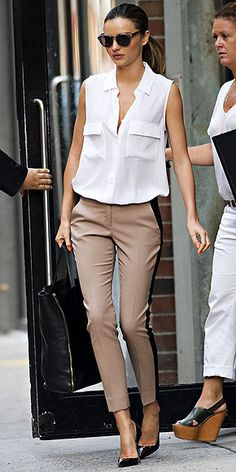 There's nothing masculine about the outfit that Miranda Kerr is rocking. Side-striped pants and white tank can immediately be made feminine with these black pointy-toe heels.
