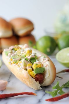 Mexican Hot Dogs with Chipotle Cream - These grilled hot dogs are topped with an avocado corn salsa and a Greek yogurt chipotle drizzle!