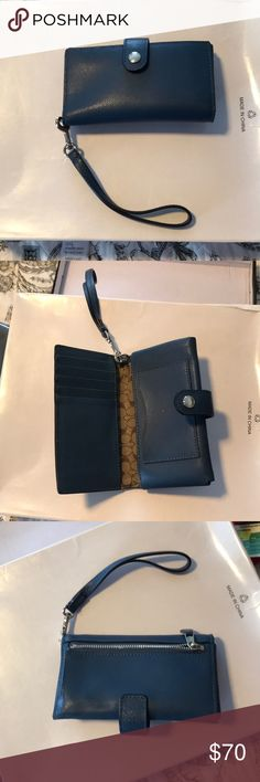 Coach wristlet wallet navy blue Original coach blue wristlet with bifold and snap closure. Has envelope closure for license and area for credit cards and two openings bifold for papers and money backside has change purse with a zipper closure. Never used great condition original coach product Coach Bags Wallets