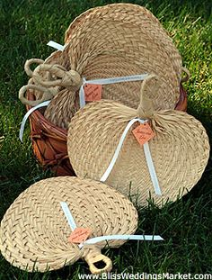 Palm leaf bamboo hand fans as wedding favors at http://www.BlissWeddingsMarket.com