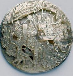 Carved MOP Button with some kind of ancient battle scene.