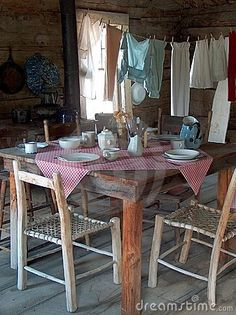 vintage farm,hand made furniture, the clothes line and checked tablecloth, wide planked flooring.