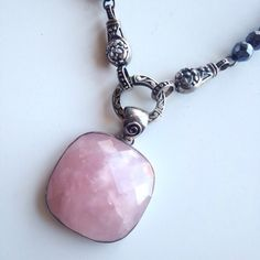 Genuine Rose Quartz Necklace Beautiful genuine rose quartz necklace pendant with genuine hematite faceted beads. Stamped sterling silver hardware. Excellent condition. Comes with velvet pouch and box. PRICE FIRM. Jewelry Necklaces