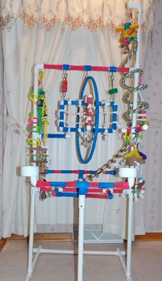 Pet Bird DIY Ideas... DIY Parrot Play Gym created by Lucy and Michael Egloff
