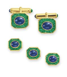 A SAPPHIRE AND EMERALD DRESS SET, BY HARRY WINSTON  Comprising a pair of cufflinks, each set with an oval cabochon sapphire within a calibré-cut emerald surround; and three shirt studs en suite, mounted in 18k gold, with maker's marks Signed Winston for Harry Winston