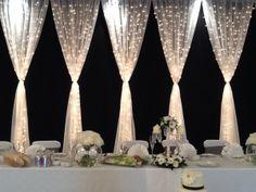fairy light curtain head table backdrop