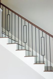 {The Staging Scoop}: Rising Trends in Stair Design Staircase iron balusters, reclaimed wood