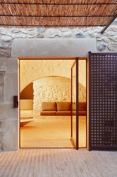 This historic farmhouse renovation by Arquitectura-G, contrasts the old stone walls of the exterior with a bright, sculptural, fresh and communal interior. Architecture Design, Contemporary Architecture, Stone Archway, Terracotta Floor, Interior And Exterior, Interior Design, Farmhouse Renovation, Glazed Tiles, Windows And Doors
