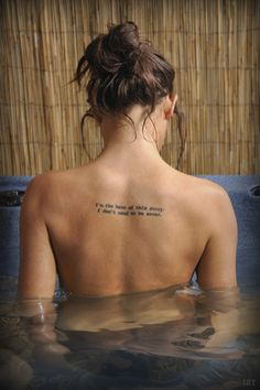 """I'm the hero in this story. i don't need to be saved."" Word tattoo, upper back"