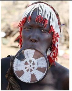 Stretching of the lips using clay plates is a symbol of sexual maturity and beauty in Southern Ethiopia. The Mursi women gradually increase the size of the plates to make their lips bigger.