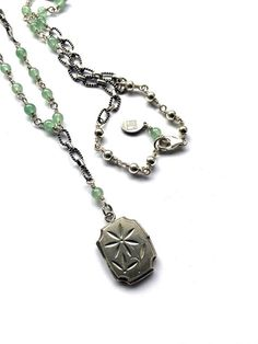 Vintage Silver Locket Necklace by Fribble Pistol.