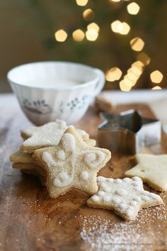 Sugar Cookies {shhhh, they're vegan} makes about 5 dozen 2 1/2 inch cookies  Cookies: 1 1/2 cups powdered sugar 1/8 teaspoon salt 1 cup soft but not melted coconut oil 1/4 cup unsweetened coconut milk, soymilk, or almond milk 1 teaspoon vanilla 2 1/2 unbleached all-purpose flour 2 tablespoons cornstarch 1 teaspoon baking soda 1 teaspoon cream of tartar Icing: 2 cups powdered sugar 2 tablespoons coconut, soy, or almond milk sprinkles or sanding sugar (optional)