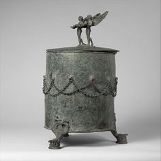"""Bronze cista (toiletries box)"" (ca. 350-325 BCE). Praenestine, Late Classical period. Posted on metmuseum.org."
