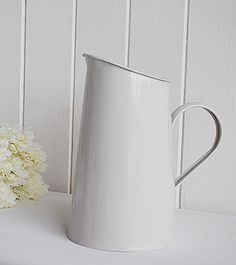 Stone enamel jug, a perfect vase for fresh flowers