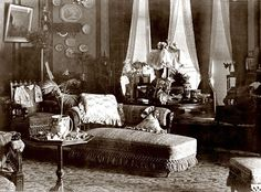 Interior view of Eldon House, 1895 – note the abundance of bric-a-brac and elaborate Victorian furnishings. Eldon House was built in 1834 for John Harris, Treasurer of the London District, and occupied by his family – his wife Amelia and their eight children. It was first named Eldon Terrace, shortly thereafter changed to Eldon House     https://fromthebygone.files.wordpress.com/2015/10/victorian1.jpg