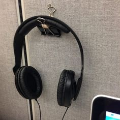 A quick and easy hanger for your headphones. | Community Post: 20 Creative Office Hacks That Will Improve Your Working Environment.