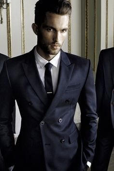 It's all about tailoring in a double breasted suit for a modern look, not your fathers box suit.
