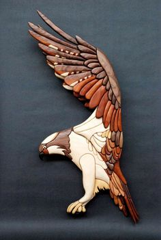 T.A.G Smith specializes in intarsia creations, he is inspired by the natural world and makes birds, animals, flowers and more out of wood. Tom has been featured in Craft & Design Magazine and was included in the catalogue for the David Shepherd Wildlife Foundation Wildlife Artist of the Year 2014.